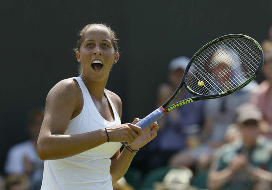 Madison Keys of the United States celebrates winning the singles match against Stefanie Voegele of Switzerland, at the All England Lawn Tennis Championships in Wimbledon, London, Wednesday July 1, 2015. Keys won 6-7, 6-3, 6-4. (AP Photo/Kirsty Wigglesworth)