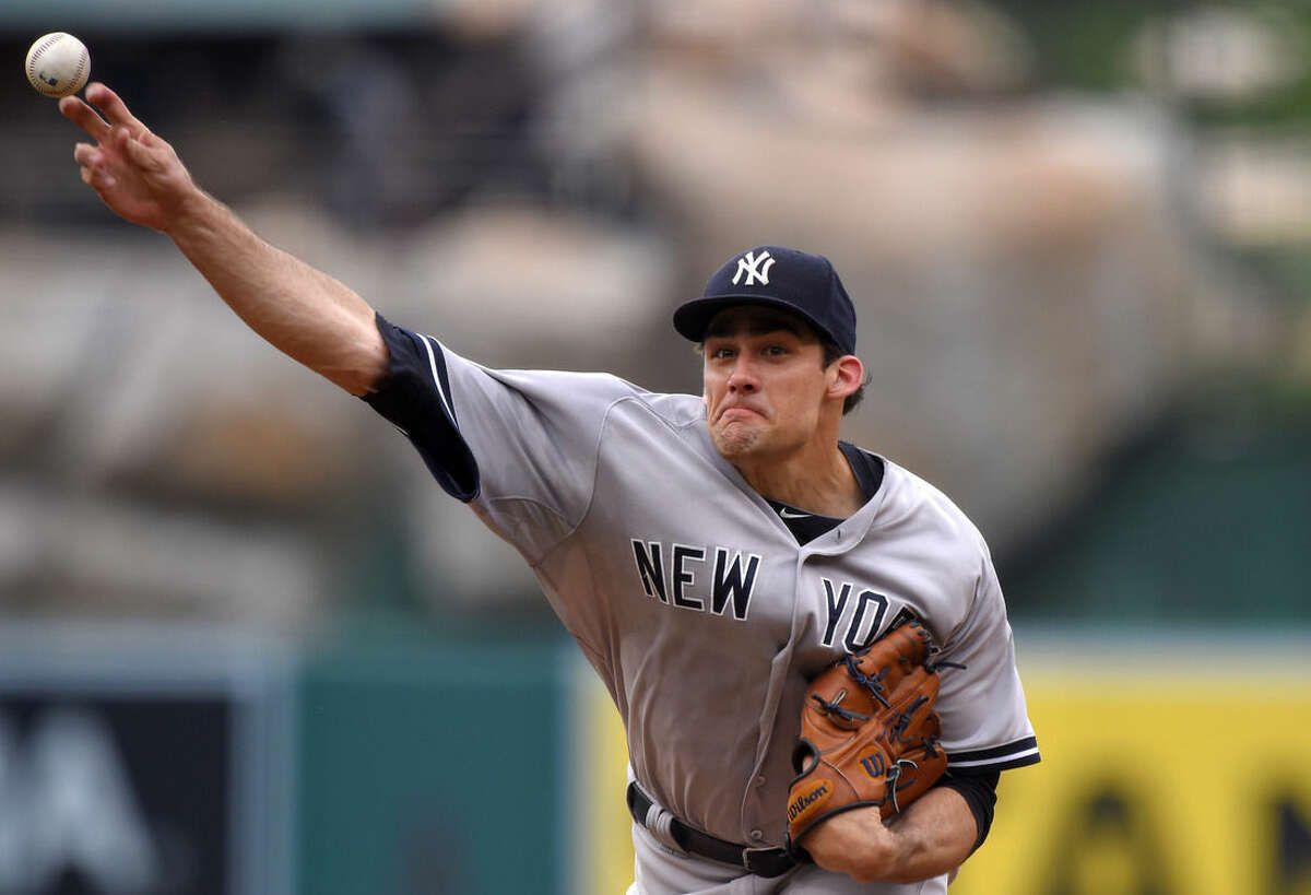 New York Yankees starting pitcher Nathan Eovaldi throws to the plate during the first inning of a baseball game against the Los Angeles Angels, Wednesday, July 1, 2015, in Anaheim, Calif. (AP Photo/Mark J. Terrill)