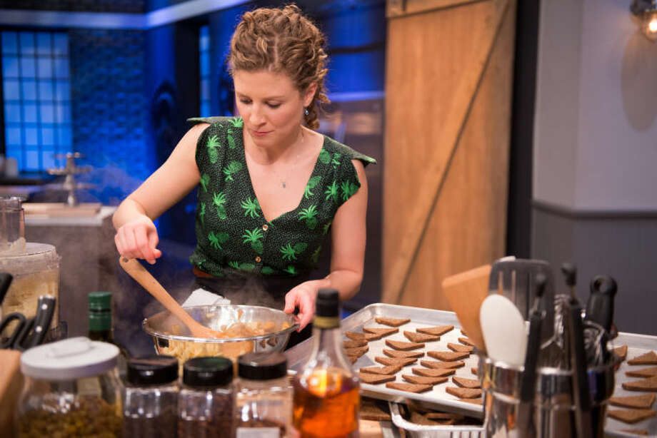 "Finalist Emma Frisch cooking her party bite for the Star Challenge ""Premiere Party"" as seen on Food Network Star, Season 10."