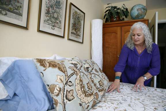 Cathryn Blum prepares a spare bedroom for an Airbnb guest at her Potrero Hill home in San Francisco, Calif. on Saturday, June 11, 2016. Blum is one of the few property owners that have followed the rules and registered as a licensed host with the city.