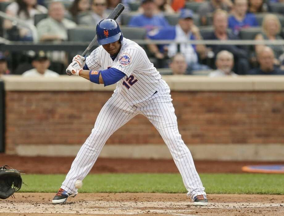 New York Mets' Juan Lagares is hit by a pitch during the second inning of a baseball game against the Chicago Cubs on Wednesday, July 1, 2015, in New York. (AP Photo/Frank Franklin II)
