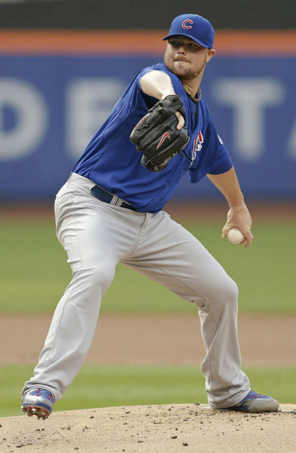 Chicago Cubs' Jon Lester delivers a pitch during the first inning of a baseball game against the New York Mets, Wednesday, July 1, 2015, in New York. (AP Photo/Frank Franklin II)