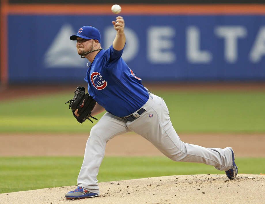 Chicago Cubs' Jon Lester delivers a pitch during the first inning of a baseball game against the New York Mets on Wednesday, July 1, 2015, in New York. (AP Photo/Frank Franklin II)
