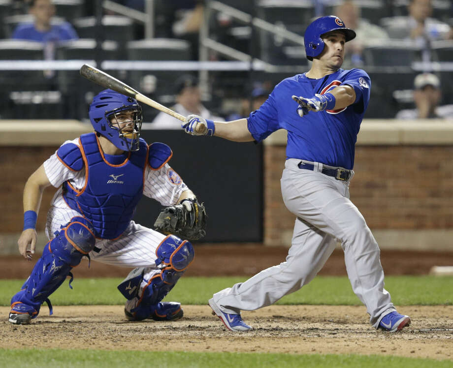 New York Mets catcher Kevin Plawecki watches as Chicago Cubs' Miguel Montero follows through on an RBI single during the 11th inning of a baseball game Wednesday, July 1, 2015, in New York. (AP Photo/Frank Franklin II)