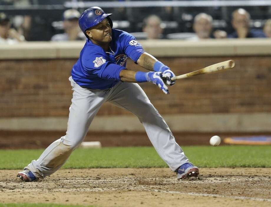 Chicago Cubs' Starlin Castro hits an hits an RBI single during the 11th inning of a baseball game against the New York Mets on Wednesday, July 1, 2015, in New York. (AP Photo/Frank Franklin II)