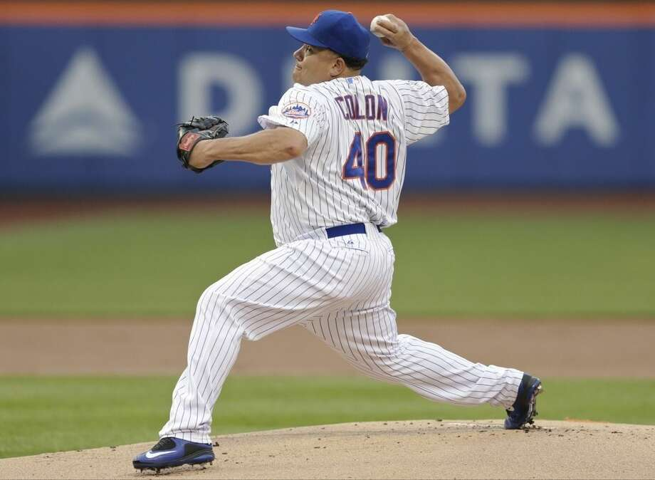 New York Mets' Bartolo Colon delivers a pitch during the first inning of a baseball game against the Chicago Cubs on Wednesday, July 1, 2015, in New York. (AP Photo/Frank Franklin II)