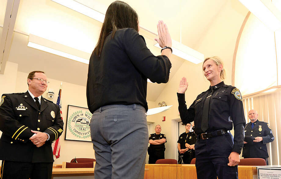 Wilton police Officer Eva Zimnoch is promoted to the rank of detective during a swearing-in ceremony conducted by Town Clerk Laurie Kaback Thursday morning.
