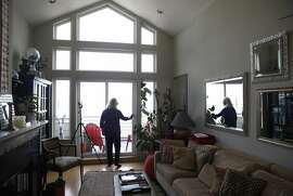 Cathryn Blum prepares the living room of her Potrero Hill home for an Airbnb guest in San Francisco, Calif. on Saturday, June 11, 2016. Blum is one of the few property owners that have followed the rules and registered as a licensed host with the city.