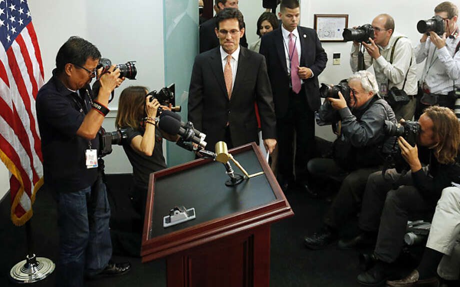 House Majority Leader Eric Cantor, R-Va., arrives to speak to reporters after a House Republican caucus meeting on Capitol Hill in Washington, Wednesday, June 11, 2014. Repudiated at the polls, Cantor intends to resign his leadership post at the end of next month, officials said, clearing the way for a potentially disruptive Republican shake-up just before midterm elections with control of Congress at stake. (AP Photo/Charles Dharapak)