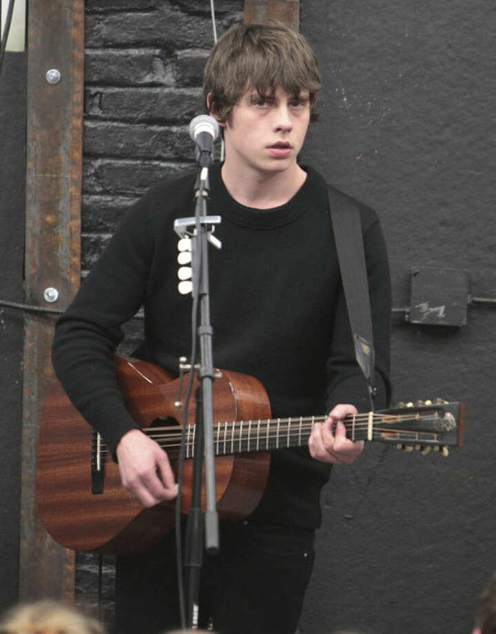 FILE - This March 21, 2014 file photo shows singer-songwriter Jake Bugg visiting The Sound Garden Records in Baltimore. Bugg is taking the next step in his own personal British Invasion plan this week, flying in to play at the Bonnaroo Music & Arts Festival in Manchester, Tennessee. (Photo by Owen Sweeney/Invision/AP, file)