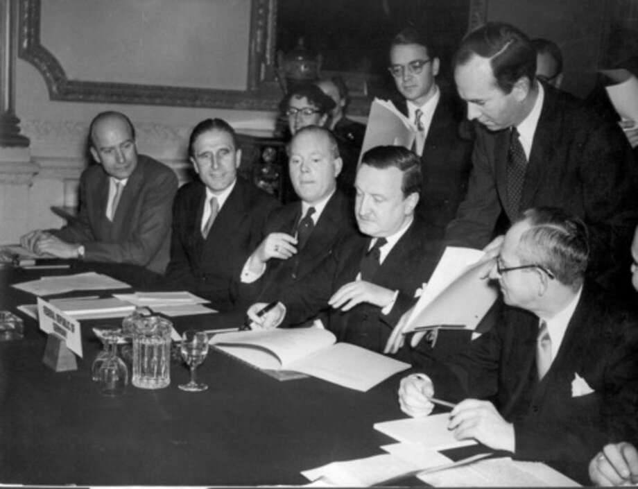 FILE - In this Feb. 27, 1953 file photo, the German Debts Agreement is signed in London. Though Germany is resisting Greece's pleas for some relief, it should know better than most what it can achieve. After the hell of World War II, the Federal Republic of Germany - more commonly known as West Germany - got massive help from its former foes, among them Greece. The agreement, in which Greece and about 20 other countries effectively wrote off a large chunk of Germany's loans and restructured the rest, is a landmark case that shows how effective debt relief can be. It helped spark what became known as the German economic miracle. (AP Photo, file)