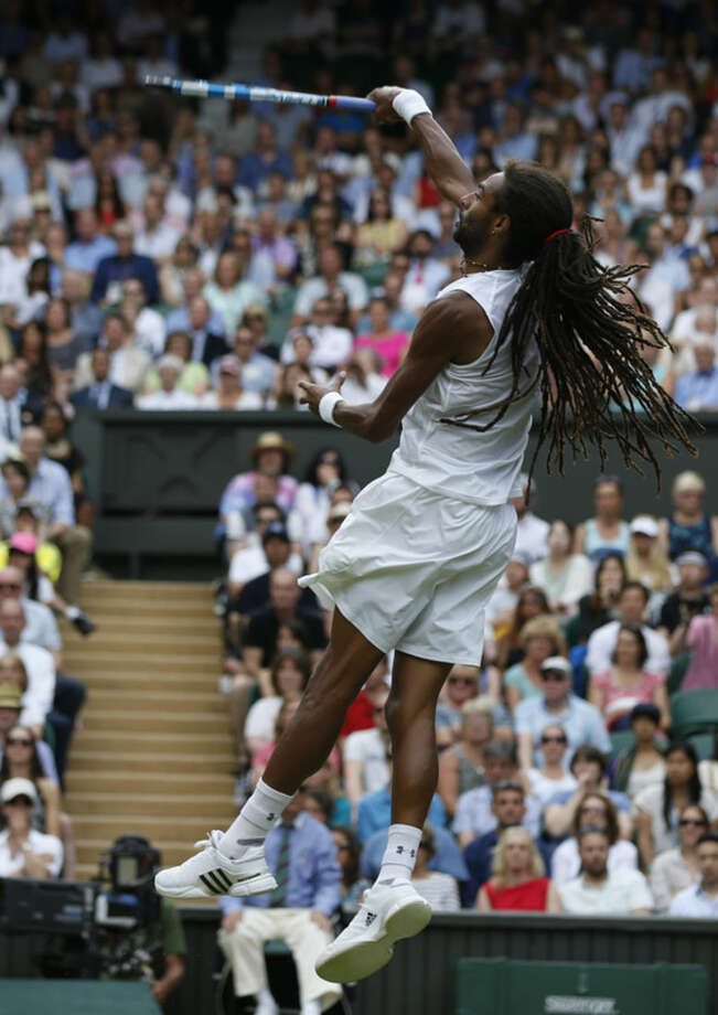 Dustin Brown of Germany returns a ball to Rafael Nadal of Spain, during their singles match at the All England Lawn Tennis Championships in Wimbledon, London, Thursday July 2, 2015. (AP Photo/Pavel Golovkin)