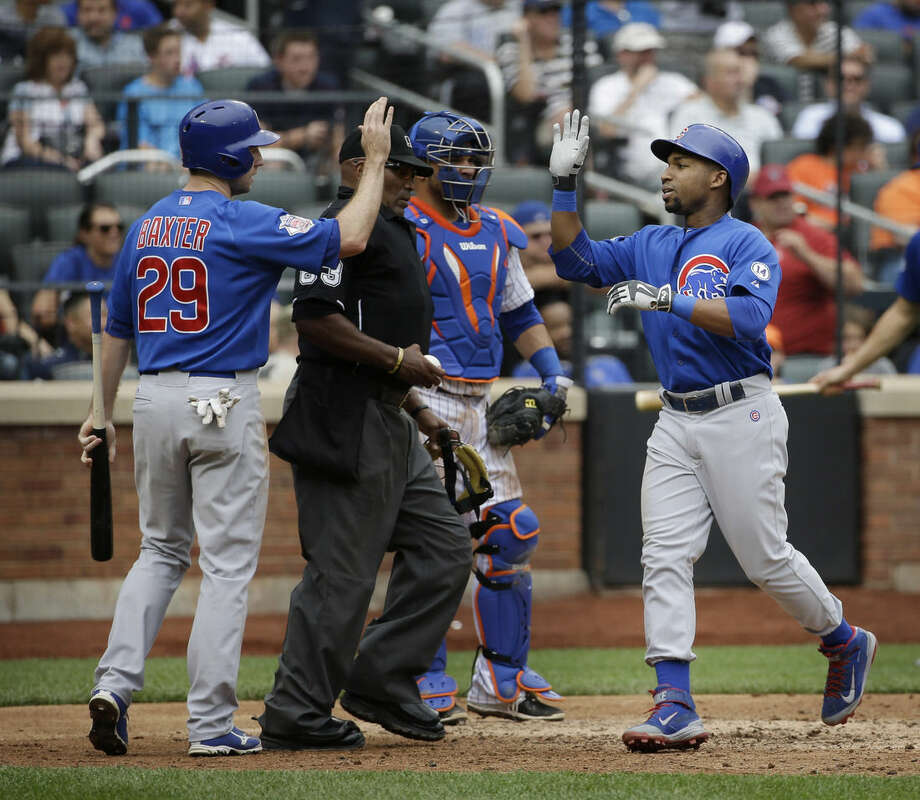 Chicago Cubs' Jonathan Herrera, right, is greeted by Mike Baxter, left, after hitting a two-run homer during the sixth inning of the baseball game against the New York Mets at Citi Field, Thursday, July 2, 2015 in New York. (AP Photo/Seth Wenig)