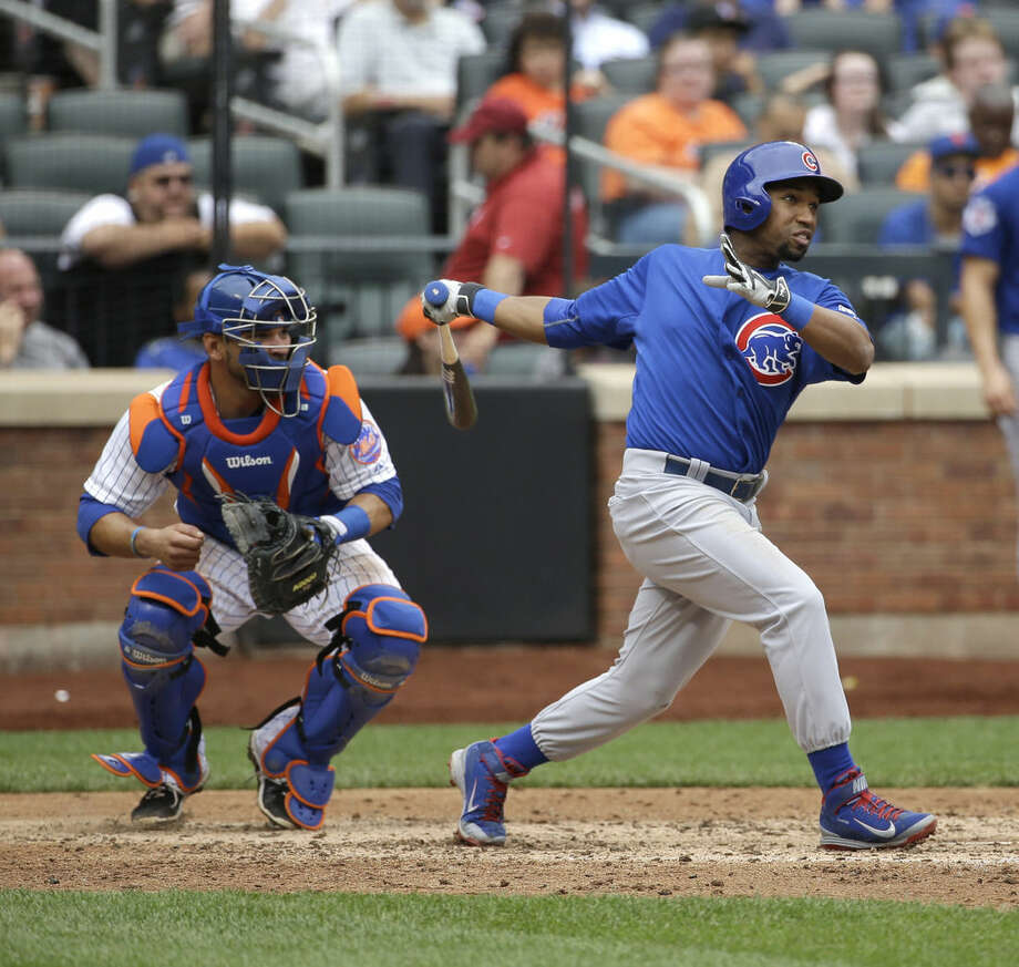 Chicago Cubs' Jonathan Herrera hits a two-run homer during the sixth inning of the baseball game against the New York Mets at Citi Field, Thursday, July 2, 2015 in New York. (AP Photo/Seth Wenig)