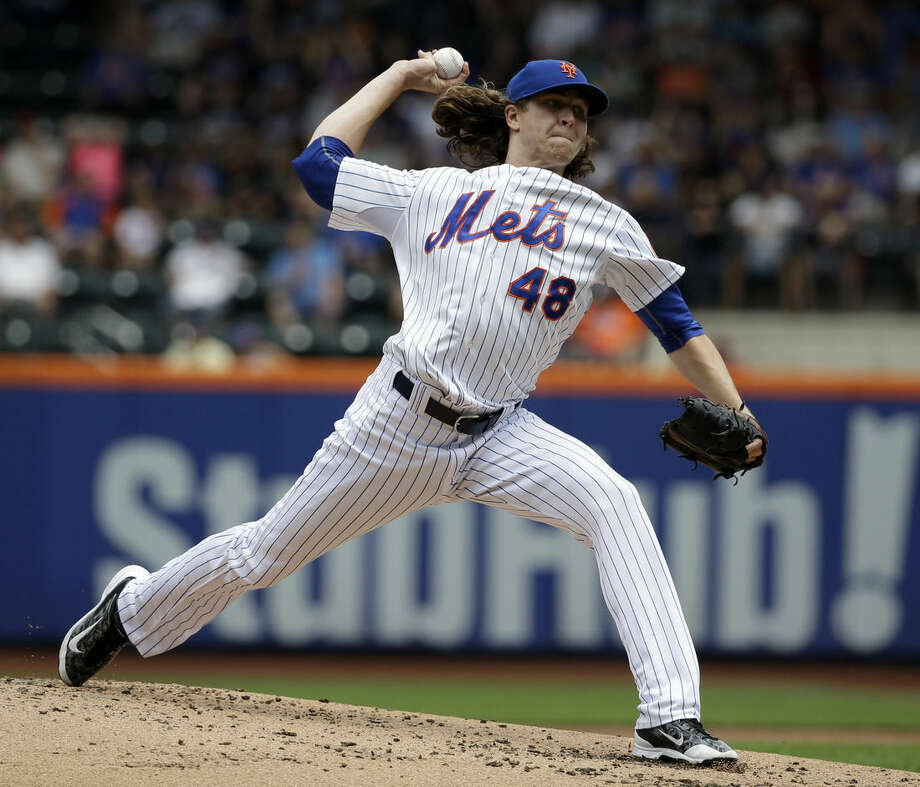 New York Mets starting pitcher Jacob deGrom throws during the second inning of the baseball game against the Chicago Cubs at Citi Field, Thursday, July 2, 2015 in New York. (AP Photo/Seth Wenig)