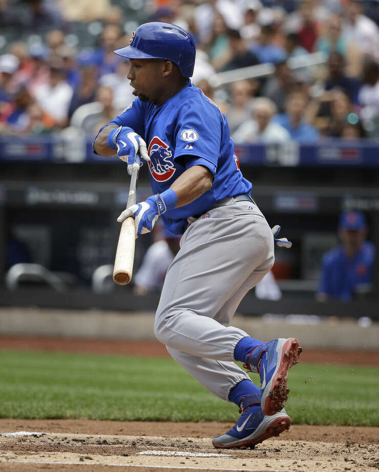 Chicago Cubs' Jonathan Herrera hits a sacrifice bunt to score a run during the second inning of the baseball game against the New York Mets at Citi Field, Thursday, July 2, 2015 in New York. (AP Photo/Seth Wenig)