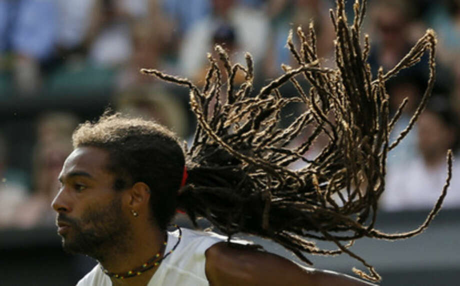 Dustin Brown of Germany returns a ball to Rafael Nadal of Spain during their singles match at the All England Lawn Tennis Championships in Wimbledon, London, Thursday July 2, 2015. (AP Photo/Pavel Golovkin)