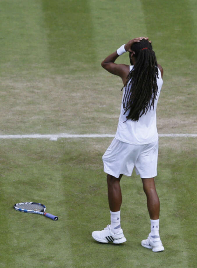 Dustin Brown of Germany gestures after winning the singles match against Rafael Nadal of Spain, at the All England Lawn Tennis Championships in Wimbledon, London, Thursday July 2, 2015. (AP Photo/Kirsty Wigglesworth)