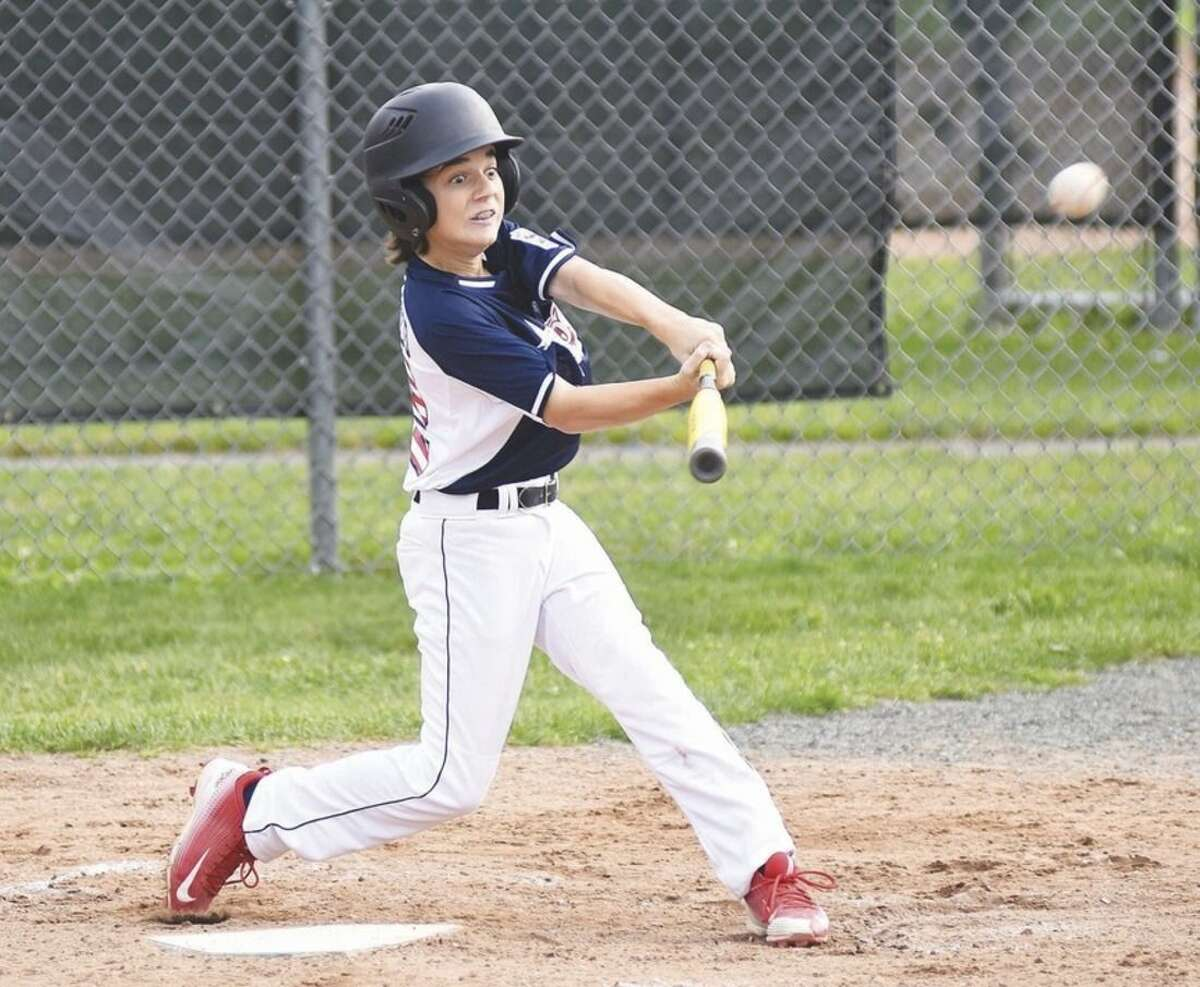 Hour photo/John Nash Westport Little League 12-year-old All-Star batter John DeDomenico's eyes light up as he rips into a pitch that turns into a two-run home run during Thursday's District 2 tournament game at Unity Park in Trumbull.
