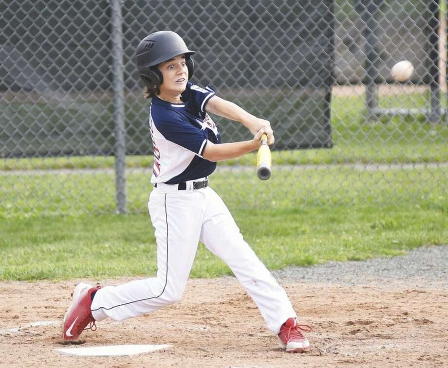 Hour photo/John NashWestport Little League 12-year-old All-Star batter John DeDomenico's eyes light up as he rips into a pitch that turns into a two-run home run during Thursday's District 2 tournament game at Unity Park in Trumbull.