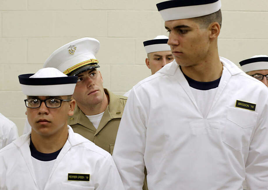 "U.S. Marine Corps 2nd Lt. Ben Pope, center, inspects prospective plebes as they stand in formation during Induction Day at the U.S. Naval Academy, Wednesday, July 1, 2015, in Annapolis, Md. More than 1,100 young men and women reported for ""I-Day,"" where they received haircuts, medical examinations, new uniforms and instructions on how to salute and address superiors before taking an oath of office to become members of academy's newest class. (AP Photo/Patrick Semansky)"