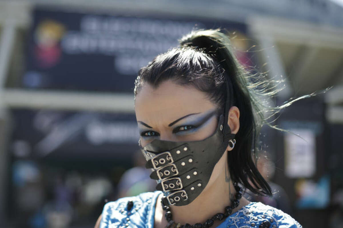 A woman who goes by Sin Fisted pauses for photos at the Electronic Entertainment Expo on Wednesday, June 11, 2014, in Los Angeles. (AP Photo/Jae C. Hong)