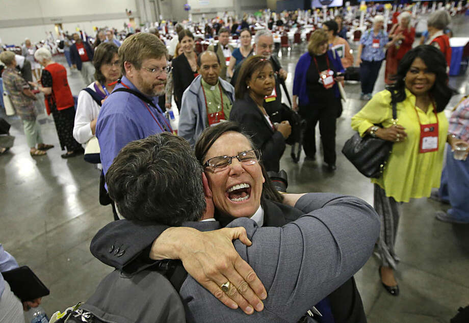 The Rev. Cynthia Black, left, and the Rev. Bonnie Perry, right, hug after Episcopalians overwhelmingly voted to allow religious weddings for same-sex couples Wednesday, July 1, 2015, in Salt Lake City. The vote came in Salt Lake City at the Episcopal General Convention, just days after the U.S. Supreme Court legalized gay marriage nationwide. (AP Photo/Rick Bowmer)