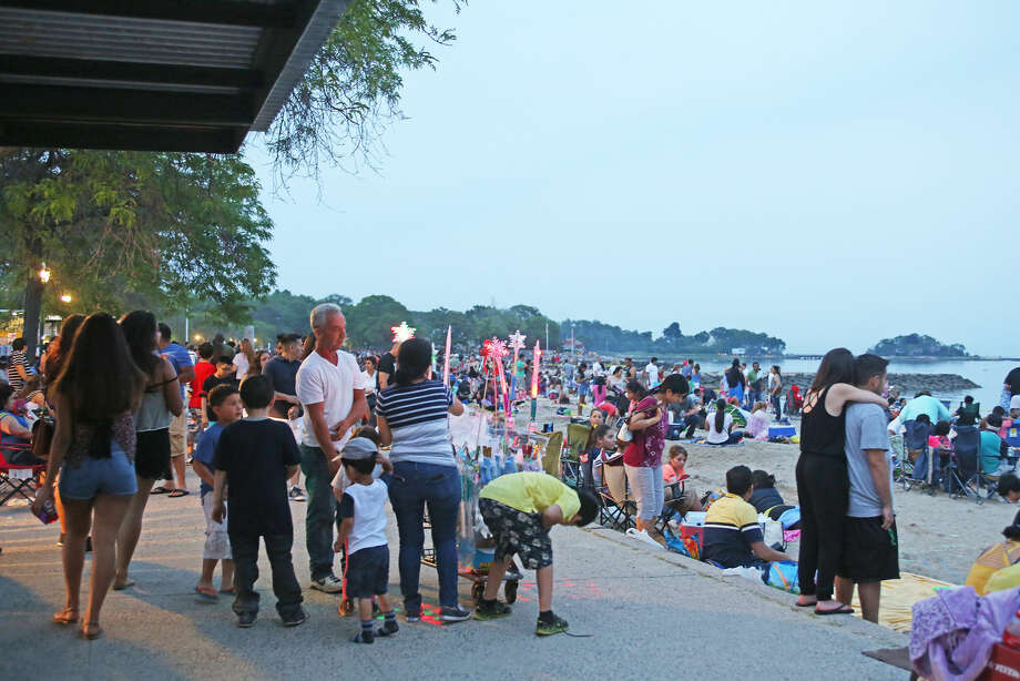 A crowded beach before the annual Stamford fireworks display at Cummings Park Thursday evening. Hour Photo / Danielle Calloway