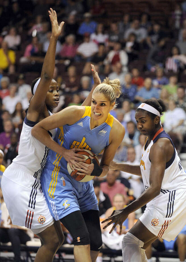 Chicago Sky's Elena Delle Donne (11), center, is guarded by Connecticut Sun's Camille Little, left, and Elizabeth Williams during the first half of a WNBA basketball game in Uncasville, Conn., on Thursday, July 2, 2015. (AP Photo/Fred Beckham)