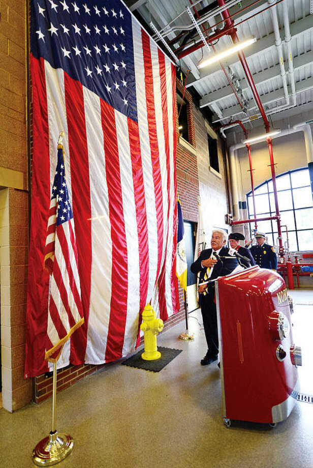 Hour photo / Erik Trautmann The Sons of the American Revolution past president Ed Isaacs leads the reciting of the pledge alliegance as organization the exemplary display of the American flag to the City of Norwalk Fire Department during a ceremony at Norwalk Fire Department Headquarters