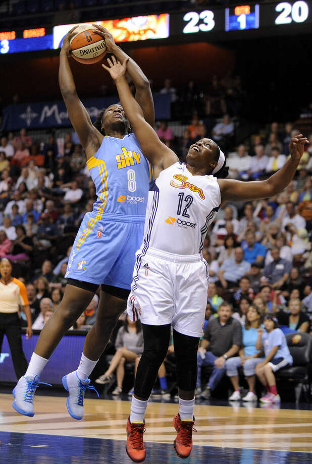 Chicago Sky's Clarissa Dos Santos (8) and Connecticut Sun's Chelsea Gray (12) fight for a rebound during the first half of a WNBA basketball game in Uncasville, Conn., on Thursday, July 2, 2015. (AP Photo/Fred Beckham)