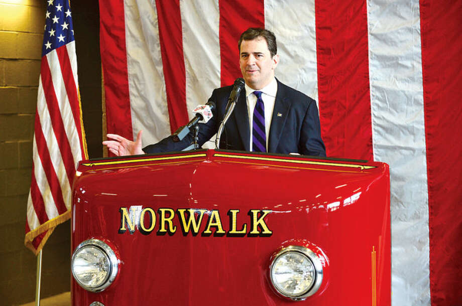 Hour photo / Erik Trautmann State Representative Chris Perone (D-137) speaks as The Sons of the American Revolution recognizes the exemplary display of the American flag by the City of Norwalk Fire Department during a ceremony at Norwalk Fire Department Headquarters Friday.