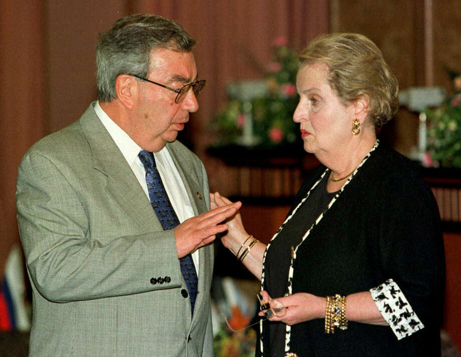 FILE - In this July 27, 1997 file photo, then-Russian Foreign Minister Yevgeny Primakov talks with then-Secretary of State Madeleine Albright in Kuala Lumpur. The stumbles, blunders, and policy chaos that have sent increasingly frosty U.S.-Russia relations into what many now call a new Cold War began might have been inevitable. The fundamental hopes and fears lurk, sometimes subconsciously, in the collective minds of the Russian and American nations despite the collapse of the Soviet Union nearly a quarter century ago. That puts their world views at odds and on a collision course, with the crisis over Ukraine the latest and biggest confrontation. (AP Photo/Mike Fiala, File)