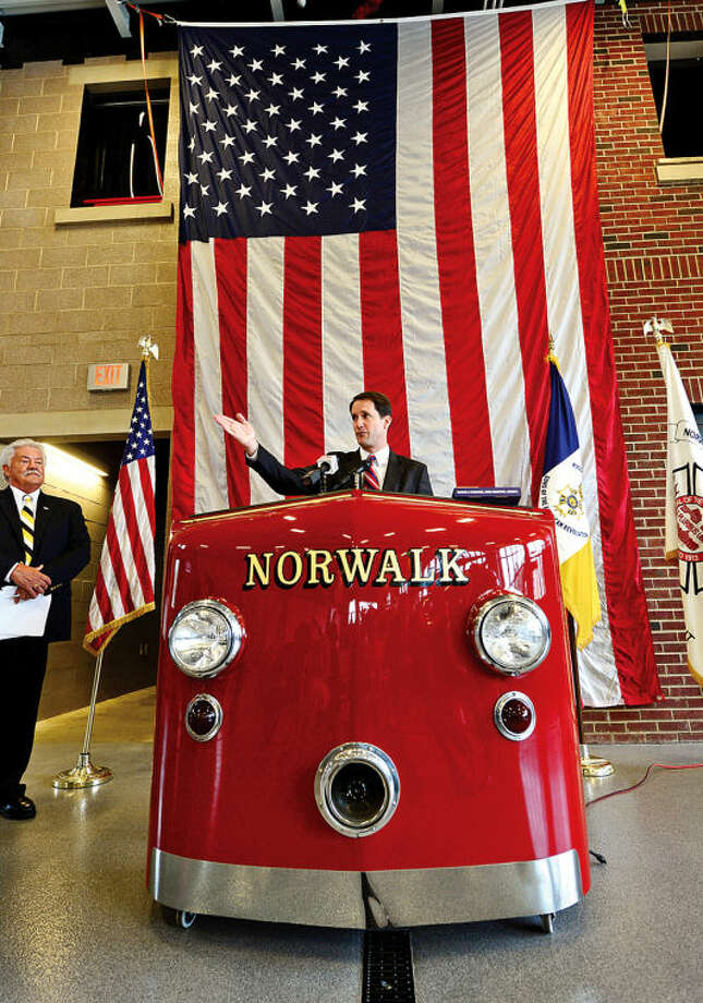 Hour photo / Erik Trautmann US Congressman Jim Himes speaks as The Sons of the American Revolution Roger Sherman Branch recognizes the exemplary display of the American flag by the City of Norwalk Fire Department during a ceremony at Norwalk Fire Department Headquarters Friday.