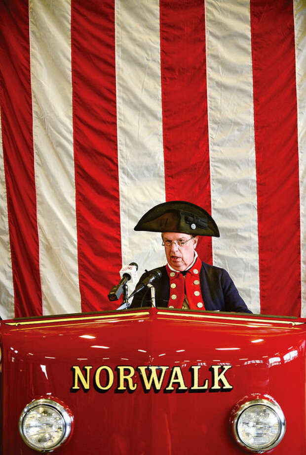 Hour photo / Erik Trautmann Member of The Sons of the American Revolution Roger Sherman Branch and revolutionary reenactor, Roger Smith, reads a peom as the organization recognizes the exemplary display of the American flag to the City of Norwalk Fire Department during a ceremony at Norwalk Fire Department Headquarters