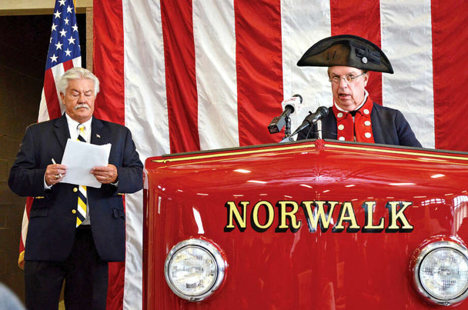 Roger Smith speaks during a ceremony held Saturday at Norwalk Fire Department Headquarters in commemoration of Flag Day.