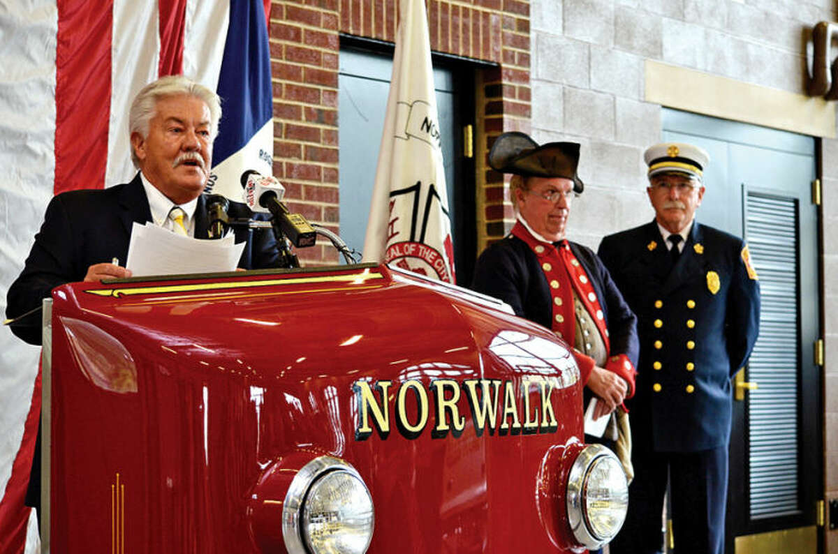 Hour photo / Liana Sonenclar Past President of the Sons of the American Revolution Roger Sherman Branch Ed Issacs speaks during a ceremony held Saturday at Norwalk Fire Department Headquarters in commemoration of Flag Day.