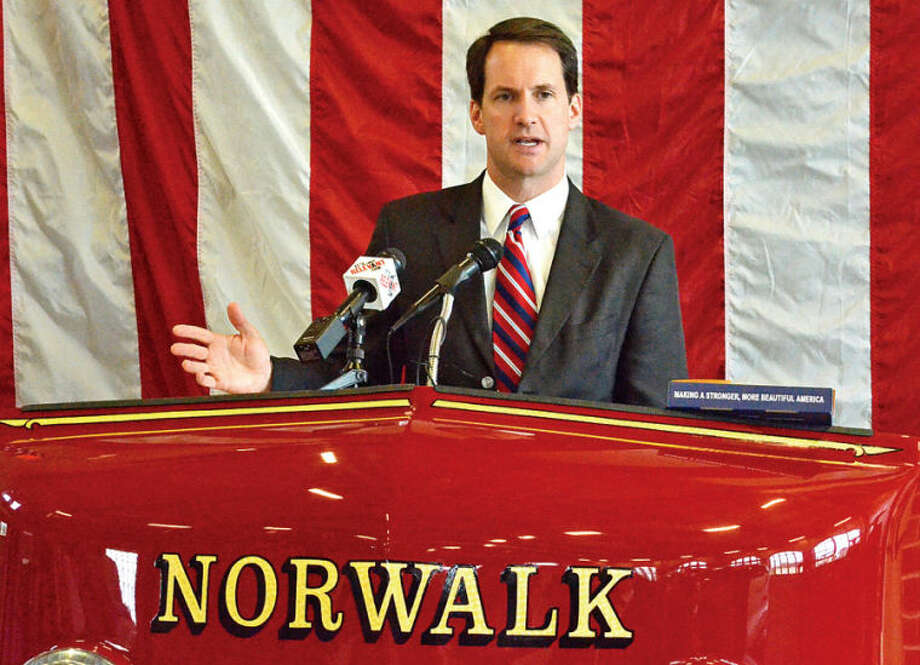 Hour photo / Liana Sonenclar Representative Jim Himes (D-4) speaks during a ceremony held Saturday at Norwalk Fire Department Headquarters in commemoration of Flag Day.