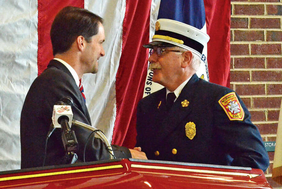 Hour photo / Liana Sonenclar Representative Jim Himes (D-4) shakes Fire Chief Denis McCarthy's hand during a ceremony held Saturday at Norwalk Fire Department Headquarters in commemoration of Flag Day.