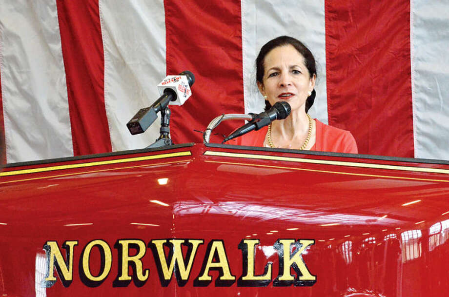 Hour photo / Liana Sonenclar State Representative Gale Lavielle (D-143) speaks during a ceremony held Saturday at Norwalk Fire Department Headquarters in commemoration of Flag Day.