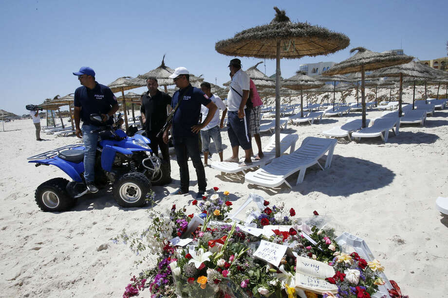 Police officers guard the scene of the attack in Sousse, Tunisia, Sunday, June 28, 2015. Tunisia's top security official says 1,000 extra police are being deployed at tourist sites and beaches in the North African nation after Friday's attack. (AP Photo/Abdeljalil Bounhar)