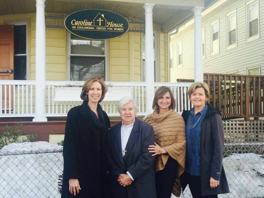 Picture in front of Caroline House with the following, from left to right:Beth Kisielius, Sister Peg Regan, Tracy Yost and Diane Johnson