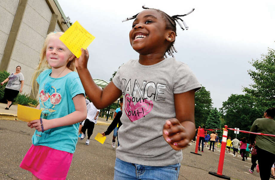 Hour photo / Erik Trautmann Fox Run Elementary School Jadah Jean Baptist holds up her lap card as the school holds their annual fundraising walkathon where students gather sponsors to help reach the fundraising goal of $10,000.00. The fundraiser will benefit a plan to buy air conditioners for all the classrooms and new playground equipment.