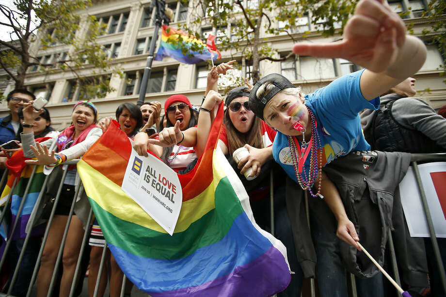 Crowds cheer on the performers during the 45th annual San Francisco Gay Pride parade Sunday, June 28, 2015, in San Francisco. A large turnout was expected for gay pride parades across the U.S. following the landmark Supreme Court ruling that said gay couples can marry anywhere in the country. (AP Photo/Tony Avelar)