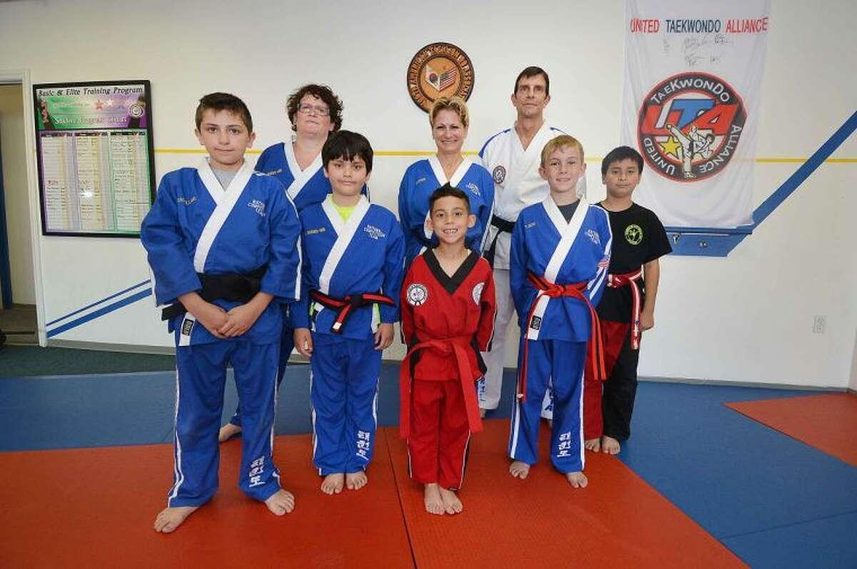 Hour Photo / Alex von Kleydorff Master Brice Bishop with The Norwalk TaekwondoAcademy National Competition Team