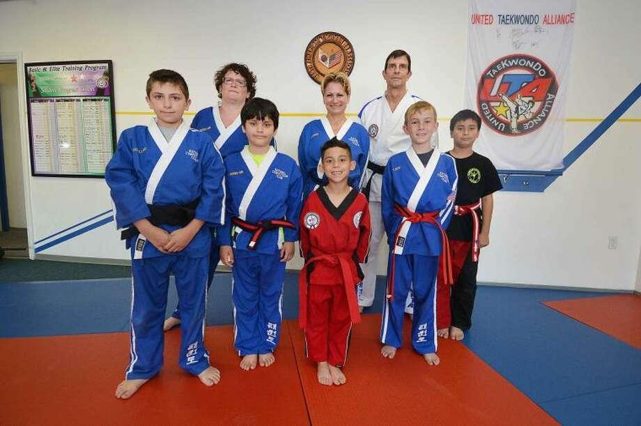 Hour Photo / Alex von KleydorffMaster Brice Bishop with The Norwalk TaekwondoAcademy National Competition Team