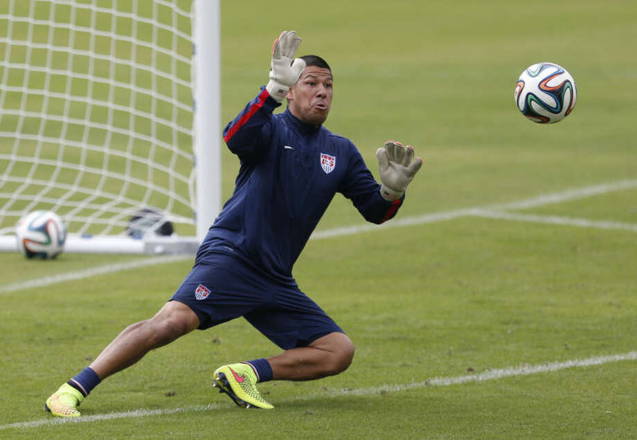 United States' goalkeeper Nick Rimando makes a save during a training session at the Sao Paulo FC training center in Sao Paulo, Brazil, Wednesday, June 11, 2014. The U.S. will play in group G of the 2014 soccer World Cup. (AP Photo/Julio Cortez)