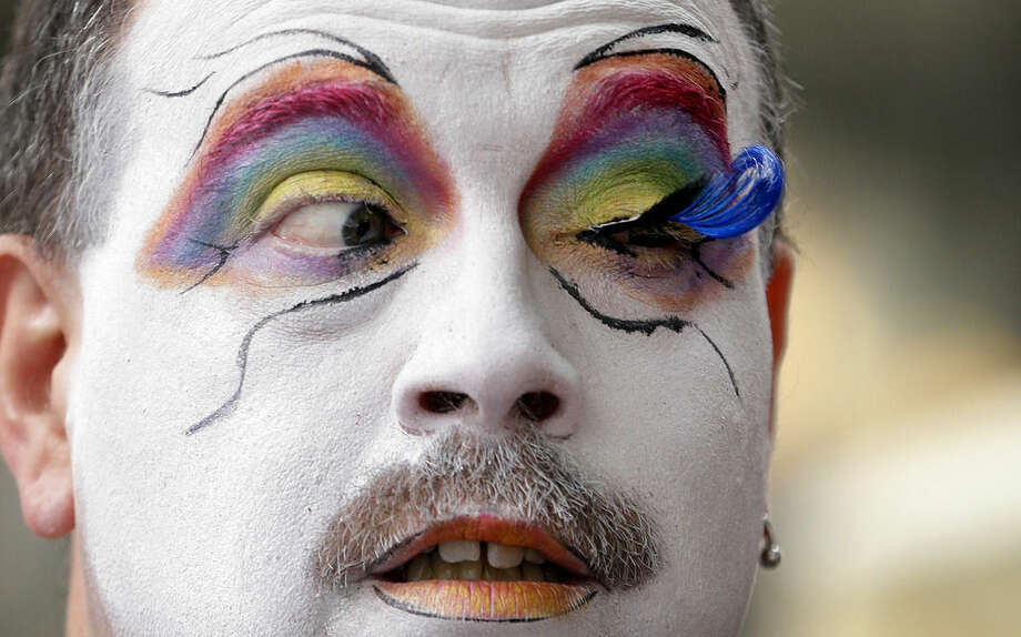 Brian Lavalle, also known as Sister Bebe Jeebus, a member of the Sisters of Perpetual Indulgence, looks across at his newly-applied eyelash as he prepares for the 41st annual Pride Parade Sunday, June 28, 2015, in Seattle. Large turnouts were expected for gay pride parades across the U.S. following the landmark Supreme Court ruling that said gay couples can marry anywhere in the country. (AP Photo/Elaine Thompson)