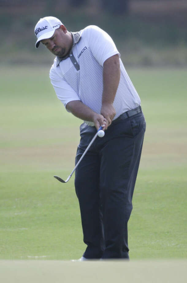 Brendon De Jonge, of Zimbabwe, chips to the green on the seventh hole during the second round of the U.S. Open golf tournament in Pinehurst, N.C., Friday, June 13, 2014. (AP Photo/Eric Gay)