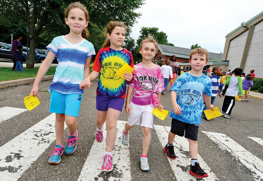 Hour photo / Erik Trautmann Fox Run Elementary School students Julia Murray, Ella Bloomfield, Ashley Rycz and Kai Bloomfield walk together as the school holds their annual fundraising walkathon where students gather sponsors to help reach the fundraising goal of $10,000.00. The fundraiser will benefit a plan to buy air conditioners for all the classrooms and new playground equipment.
